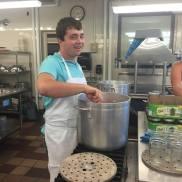 Sam stirring salsa